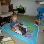 Xander reading on his own