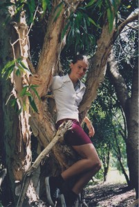 Me up a tree in my school uniform, because that was 50% of my school life.